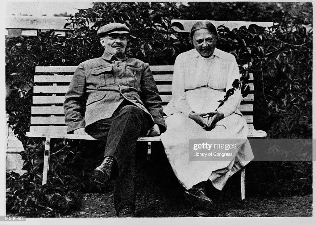 Vladimir Lenin and wife Nadezhda Krupskaya relax on a bench together in Gorki Park.
