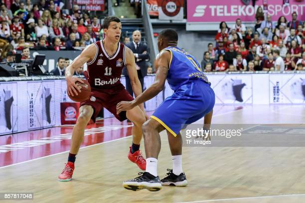 Vladimir Lucic of Bayern Muenchen and Jarekious Bradley of Braunschweig battle for the ball during the easyCredit BBL Basketball Bundesliga match...