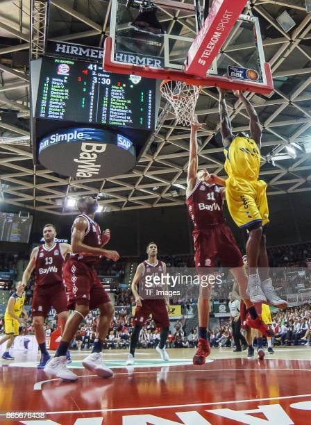 Vladimir Lucic of Bayern Muenchen and Rickey Paulding of Oldenburg battle for the ball during the easyCredit BBL Basketball Bundesliga match between...
