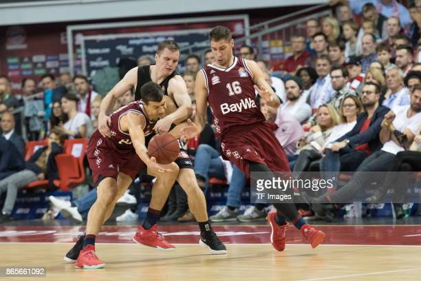 Vladimir Lucic of Bayern Muenchen Vytenis Lipkevicius of Wuerzburg and Stefan Jovic of Bayern Muenchen battle for the ball during the easyCredit BBL...