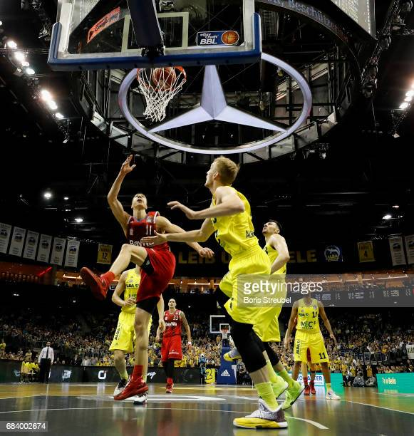 Vladimir Lucic of FC Bayern Muenchen is challenged by Niels Giffey of ALBA Berlin during the easyCredit BBL Basketball Bundesliga match between Alba...