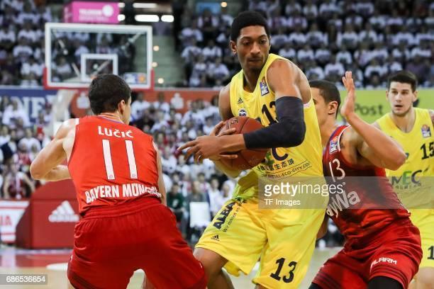 Vladimir Lucic of Munich Nick Johnson of Munich und Malcolm Miller of Berlin battle for the ball during the easyCredit BBL Basketball Bundesliga...