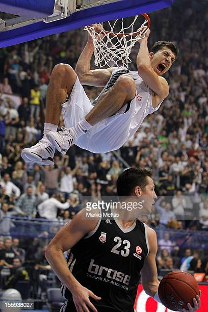 Vladimir Lucic of Partizan mts Belgrade and Casey Jacobsen #23 of Brose Baskets Bamberg in action during the 20122013 Turkish Airlines Euroleague...