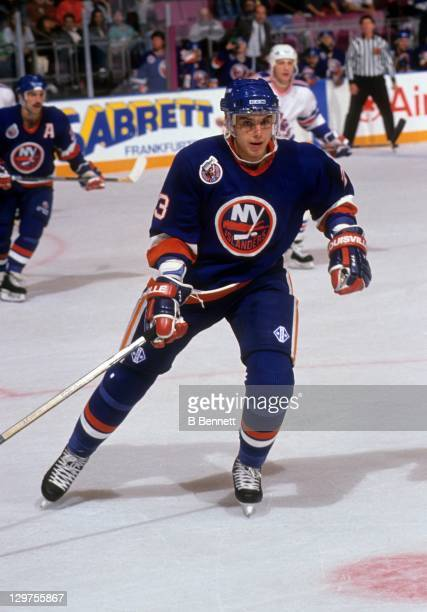 Vladimir Malakhov of the New York Islanders skates on the ice during an NHL game against the New York Rangers on October 18 1992 at the Madison...