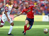 Vladimir Marin of Independiente Medellin struggles for the ball with Wilmar Barrios of Deportes Tolima during a semifinal match between Medellin and...