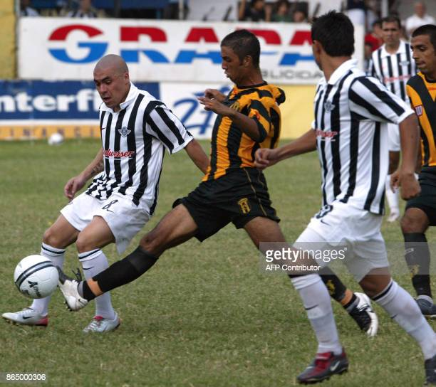 Vladimir Marin of Libertad is marked by Luis Maidana of Guarani during the final match of the 2007 Paraguayan closure championship 25 November 2007...