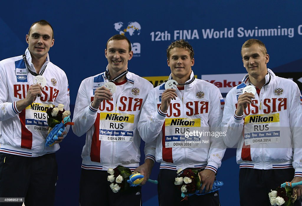 <a gi-track='captionPersonalityLinkClicked' href=/galleries/search?phrase=Vladimir+Morozov+-+Swimmer&family=editorial&specificpeople=6614710 ng-click='$event.stopPropagation()'>Vladimir Morozov</a>, Sergei Feskiov, <a gi-track='captionPersonalityLinkClicked' href=/galleries/search?phrase=Danila+Izotov&family=editorial&specificpeople=5489189 ng-click='$event.stopPropagation()'>Danila Izotov</a> and <a gi-track='captionPersonalityLinkClicked' href=/galleries/search?phrase=Mikhail+Polishchuk&family=editorial&specificpeople=7140130 ng-click='$event.stopPropagation()'>Mikhail Polishchuk</a> of Russia celebrates on the podium after the Men's 4x100m Freestyle Relay Final during day one of the 12th FINA World Swimming Championships (25m) at the Hamad Aquatic Centre on December 3, 2014 in Doha, Qatar.
