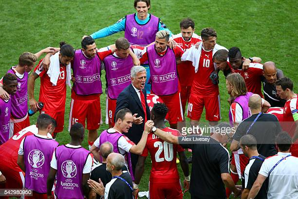 Vladimir Petkovic head coach of Switzerland instructs while players and staffs a huddle prior to the penalty shootout during the UEFA EURO 2016 round...