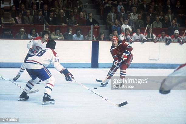 Vladimir Petrov of the Moscow Central Red Army skates against defenseman Serge Savard of the Montreal Canadiens during their game on December 31 1975...