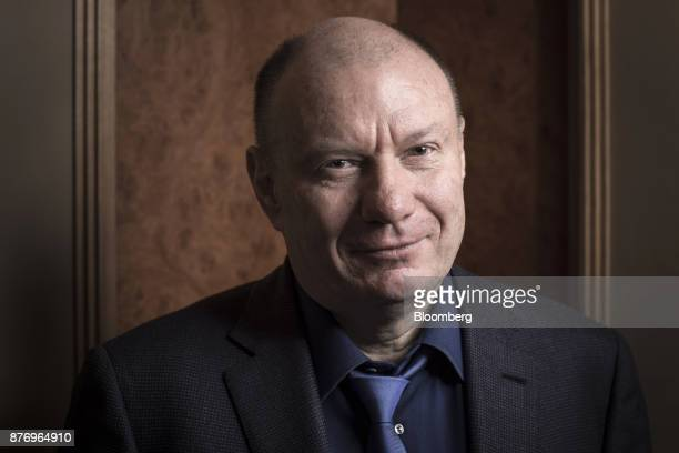 Vladimir Potanin billionaire and owner of OAO GMK Norilsk Nickel poses for a photograph following an interview in London UK on Monday Nov 20 2017...