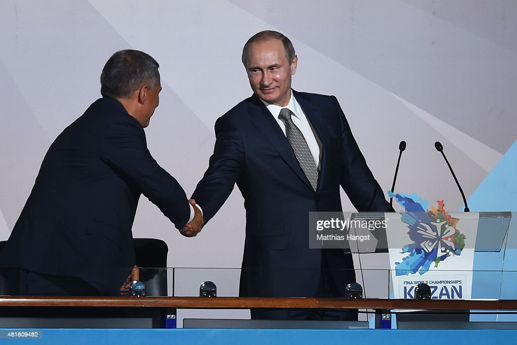 Vladimir Putin (R), President of Russia shakes hands with Rustam Minnikhanov, Acting President of the Republic of Tatarstan during the Opening Ceremony of the 16th FINA World Championships at TatNeft Arena on July 24, 2015 in Kazan, Russia.