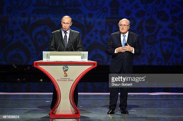 Vladimir Putin President of Russia speaks as FIFA President Joseph S Blatter looks on during the Preliminary Draw of the 2018 FIFA World Cup in...