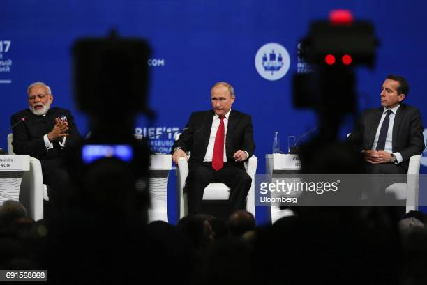 Vladimir Putin Russia's president center and Christian Kern Austria's chancellor right listen as Narendra Modi India's prime minister speaks at the...