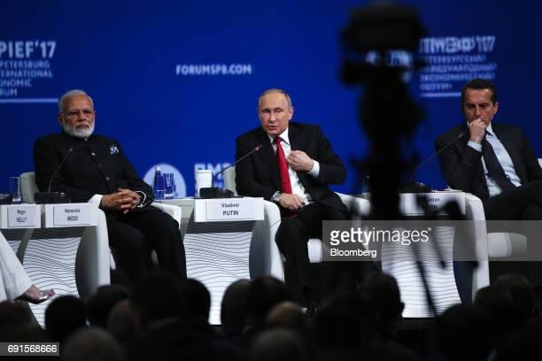 Vladimir Putin Russia's president center speaks as Narendra Modi India's prime minister left and Christian Kern Austria's chancellor listen at the...
