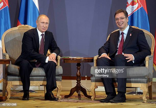 Vladimir Putin Russia's president left and Aleksandar Vucic Serbia's prime minister pose for a photograph ahead of their meeting in Belgrade Serbia...