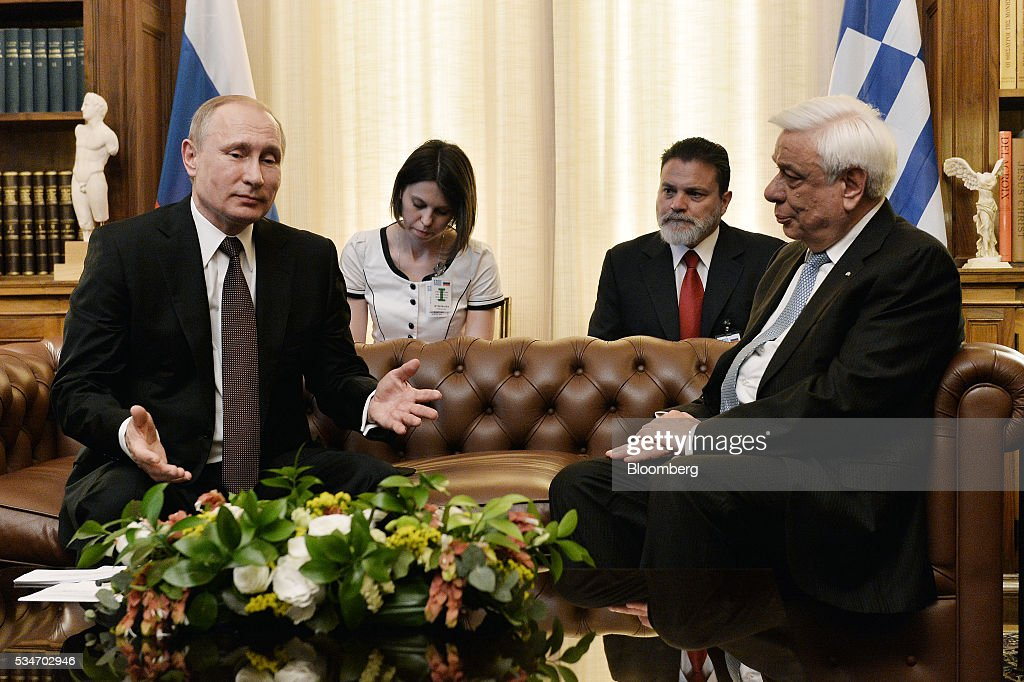 Vladimir Putin, Russia's president, left, speaks with Prokopis Pavlopoulos, Greece's president, at the presidential palace in Athens, Greece, on Friday, May 27, 2016. The Russian president is visiting Athens at a time when Greece is turning a page, economic recovery is in prospect, Alexis Tsipras, Greece's prime minister, said in comments at start of meeting. Photographer: Louisa Gouliamaki/Pool via Bloomberg