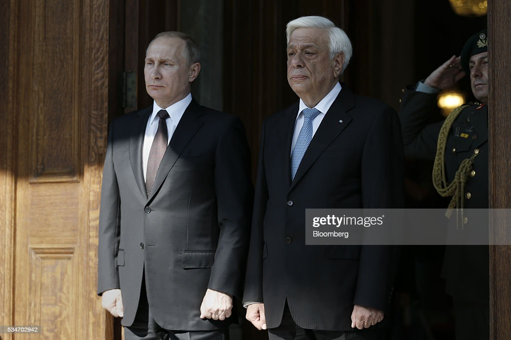Vladimir Putin, Russia's president, left, stands with <a gi-track='captionPersonalityLinkClicked' href=/galleries/search?phrase=Prokopis+Pavlopoulos&family=editorial&specificpeople=4517908 ng-click='$event.stopPropagation()'>Prokopis Pavlopoulos</a>, Greece's president, at the presidential palace in Athens, Greece, on Friday, May 27, 2016. The Russian president is visiting Athens at a time when Greece is turning a page, economic recovery is in prospect, Alexis Tsipras, Greece's prime minister, said in comments at start of meeting. Photographer: Alkis Konstantinidis/Pool via Bloomberg