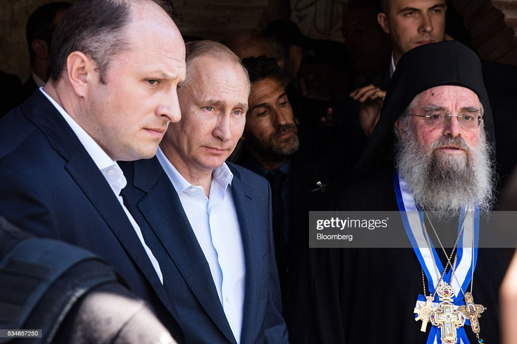 <a gi-track='captionPersonalityLinkClicked' href=/galleries/search?phrase=Vladimir+Putin&family=editorial&specificpeople=154896 ng-click='$event.stopPropagation()'>Vladimir Putin</a>, Russia's president, looks on during a visit to Mount Athos, Greece, on Saturday, May 28, 2016. Putin arrived at the northern Greek peninsula of Mount Athos, on a visit to the autonomous Orthodox Christian monastic community. Photographer: Konstantinos Tsakalidis/Bloomberg via Getty Images