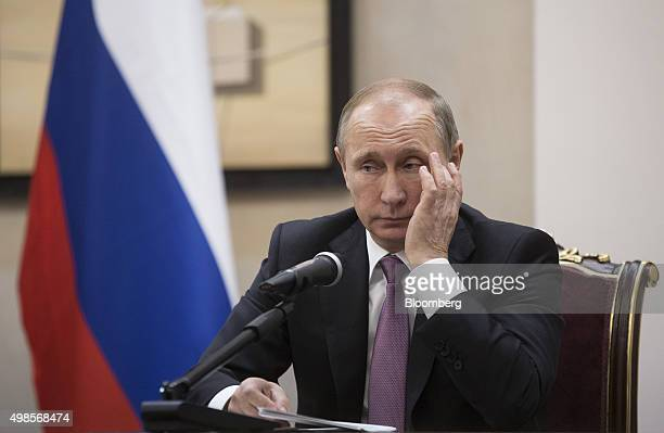 Vladimir Putin Russia's president pauses during a news conference alongside Hassan Rouhani Iran's president not pictured at the Gas Exporting...