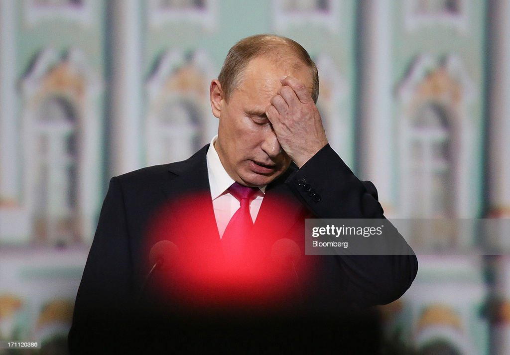 <a gi-track='captionPersonalityLinkClicked' href=/galleries/search?phrase=Vladimir+Putin&family=editorial&specificpeople=154896 ng-click='$event.stopPropagation()'>Vladimir Putin</a>, Russia's president, reacts while speaking during a session with Angela Merkel, Germany's chancellor, on day two of the St. Petersburg International Economic Forum 2013 (SPIEF) in St. Petersburg, Russia, on Friday, June 21, 2013. Putin is battling investor skepticism to woo foreign executives descending on his hometown today as Russia's economy faces a risk of recession and a crackdown on critics scares off intellectuals. Photographer: Andrey Rudakov/Bloomberg via Getty Images