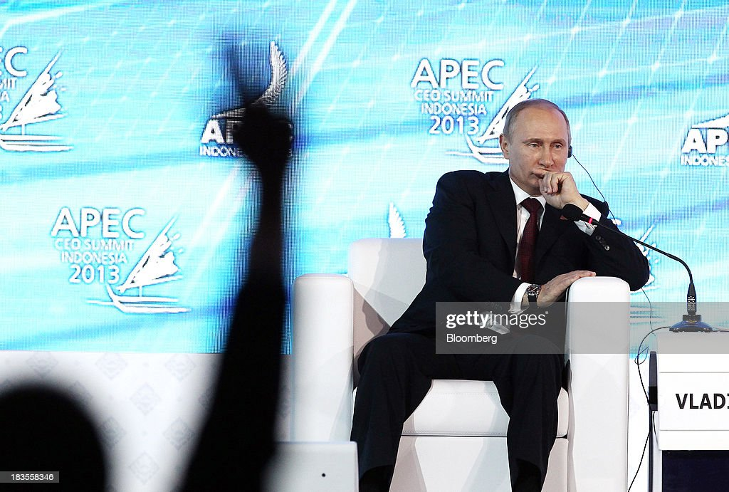 <a gi-track='captionPersonalityLinkClicked' href=/galleries/search?phrase=Vladimir+Putin&family=editorial&specificpeople=154896 ng-click='$event.stopPropagation()'>Vladimir Putin</a>, Russia's president, sits and listens during a session at the Asia-Pacific Economic Cooperation (APEC) CEO Summit in Nusa Dua, Bali, Indonesia, on Monday, Oct. 7, 2013. Asia-Pacific governments are calling for vigilance against protectionism as economic growth slows in parts of the region and completion of a 12-nation trade accord looks set to be delayed further. Photographer: SeongJoon Cho/Bloomberg via Getty Images