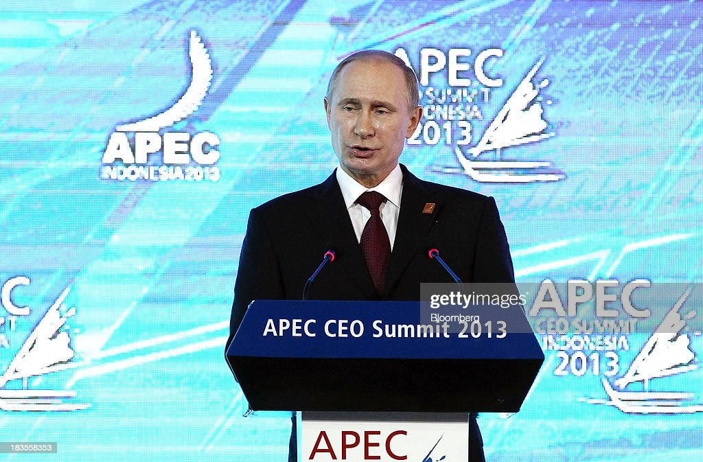 <a gi-track='captionPersonalityLinkClicked' href=/galleries/search?phrase=Vladimir+Putin&family=editorial&specificpeople=154896 ng-click='$event.stopPropagation()'>Vladimir Putin</a>, Russia's president, speaks at the Asia-Pacific Economic Cooperation (APEC) CEO Summit in Nusa Dua, Bali, Indonesia, on Monday, Oct. 7, 2013. Asia-Pacific governments are calling for vigilance against protectionism as economic growth slows in parts of the region and completion of a 12-nation trade accord looks set to be delayed further. Photographer: SeongJoon Cho/Bloomberg via Getty Images