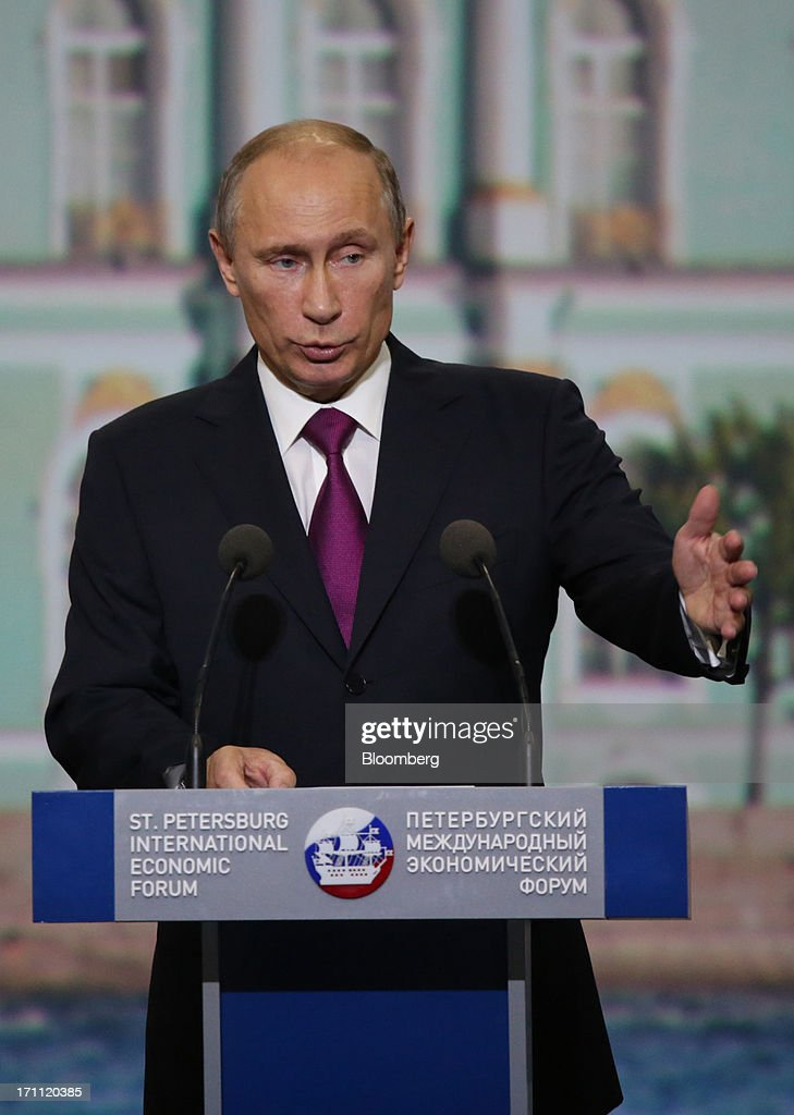 <a gi-track='captionPersonalityLinkClicked' href=/galleries/search?phrase=Vladimir+Putin&family=editorial&specificpeople=154896 ng-click='$event.stopPropagation()'>Vladimir Putin</a>, Russia's president, speaks during a session with Angela Merkel, Germany's chancellor, on day two of the St. Petersburg International Economic Forum 2013 (SPIEF) in St. Petersburg, Russia, on Friday, June 21, 2013. Putin is battling investor skepticism to woo foreign executives descending on his hometown today as Russia's economy faces a risk of recession and a crackdown on critics scares off intellectuals. Photographer: Andrey Rudakov/Bloomberg via Getty Images