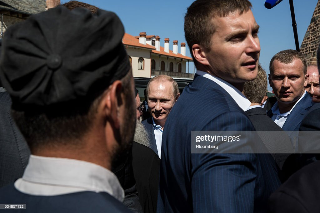 Vladimir Putin, Russia's president, stands surrounded by security guards during a visit to Mount Athos, Greece, on Saturday, May 28, 2016. Putin arrived at the northern Greek peninsula of Mount Athos, on a visit to the autonomous Orthodox Christian monastic community. Photographer: Konstantinos Tsakalidis/Bloomberg via Getty Images