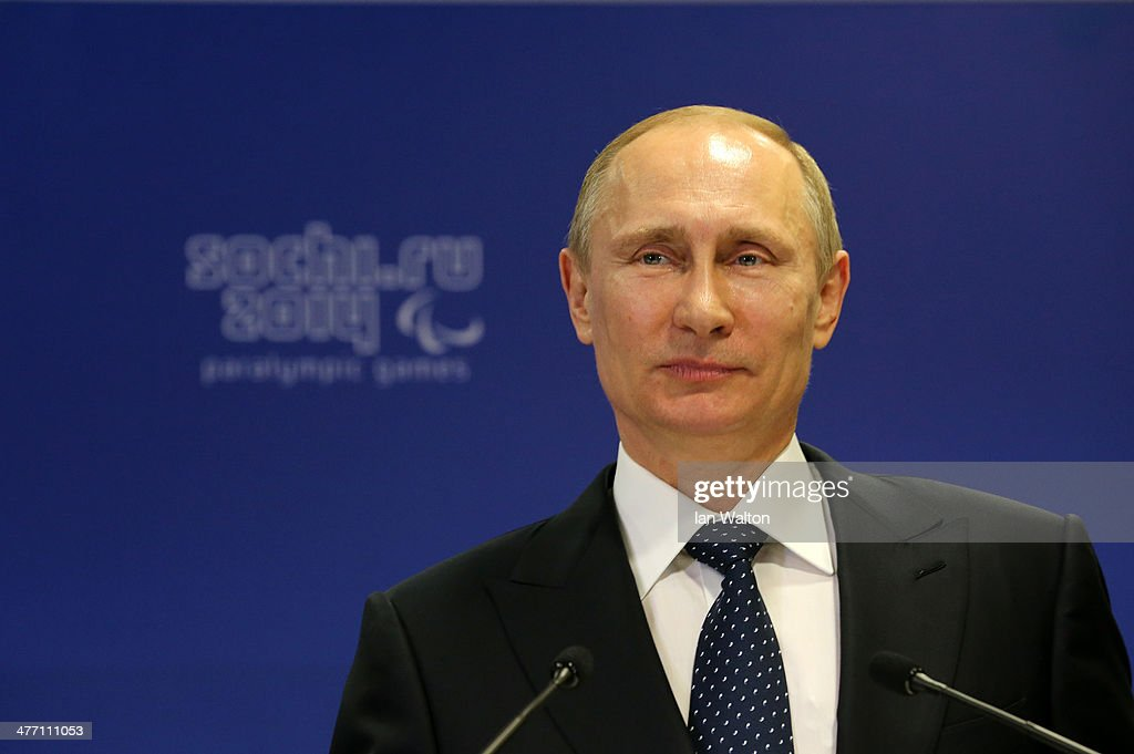 <a gi-track='captionPersonalityLinkClicked' href=/galleries/search?phrase=Vladimir+Putin&family=editorial&specificpeople=154896 ng-click='$event.stopPropagation()'>Vladimir Putin</a> the President of Russia speaks to the IPC Governing Board prior to the Opening Ceremony of the Sochi 2014 Paralympic Winter Games at Fisht Olympic Stadium on March 7, 2014 in Sochi, Russia.