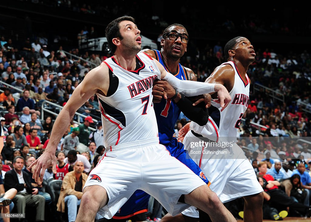 <a gi-track='captionPersonalityLinkClicked' href=/galleries/search?phrase=Vladimir+Radmanovic&family=editorial&specificpeople=201834 ng-click='$event.stopPropagation()'>Vladimir Radmanovic</a> #77 of the Atlanta Hawks battles for position against <a gi-track='captionPersonalityLinkClicked' href=/galleries/search?phrase=Amar%27e+Stoudemire&family=editorial&specificpeople=201492 ng-click='$event.stopPropagation()'>Amar'e Stoudemire</a> #1 of the New York Knicks on April 22, 2012 at Philips Arena in Atlanta, Georgia.