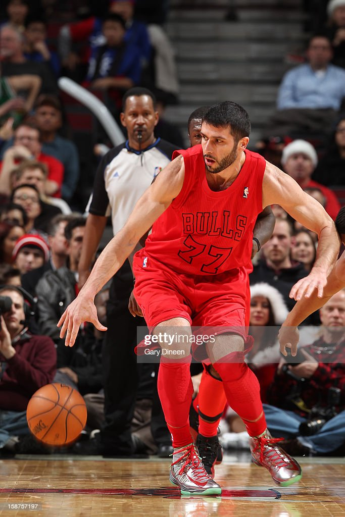 Vladimir Radmanovic #77 of the Chicago Bulls dribbles the ball against the Houston Rockets during a Christmas Day game on December 25, 2012 at the United Center in Chicago, Illinois.