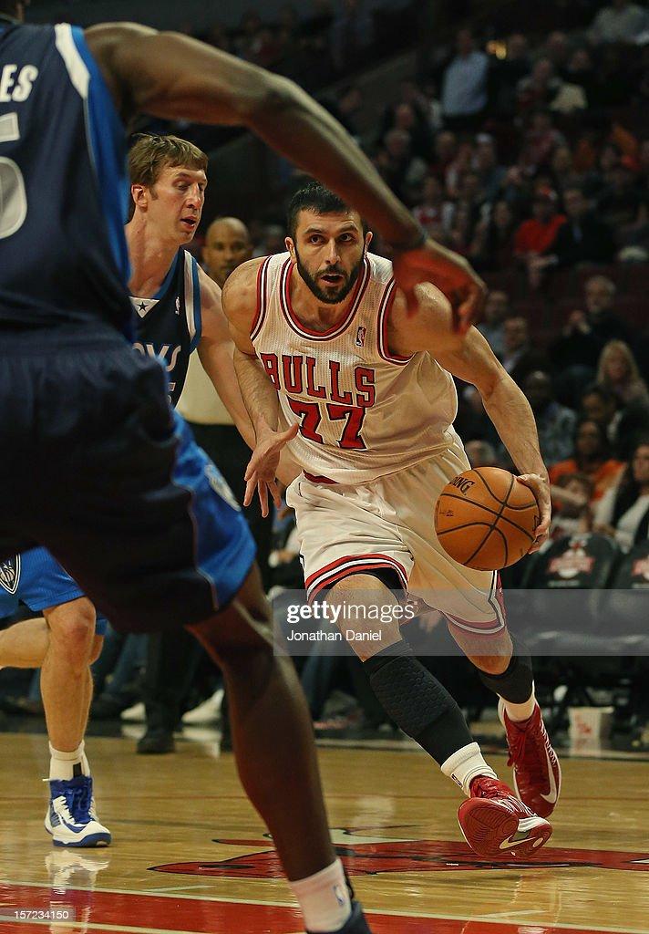 Vladimir Radmanovic #77 of the Chicago Bulls moves against Troy Murphy #6 and Bernard James #5 of the Dallas Mavericks at the United Center on November 28, 2012 in Chicago, Illinois. The Bulls defeated the Mavericks 101-78.
