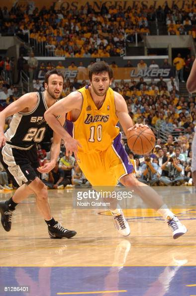Vladimir Radmanovic of the Los Angeles Lakers drives past Manu Ginobili of the San Antonio Spurs in Game Five of the Western Conference Finals during...