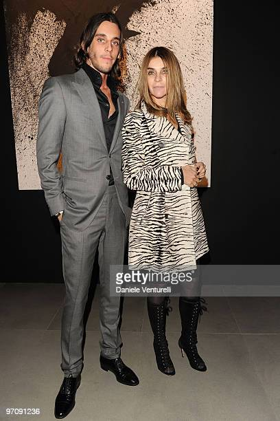 Vladimir Restoin Roitfeld and Carine Roitfeld attend Richard Hambleton Exhibition during Milan Fashion Week Womenswear Autumn/Winter 2010 show on...