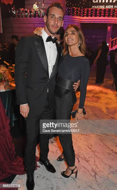 Vladimir Restoin Roitfeld and Carine Roitfeld attend the amfAR Gala Cannes 2017 at Hotel du CapEdenRoc on May 25 2017 in Cap d'Antibes France