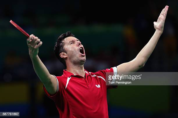 Vladimir Samsonov of Belarus celebrates after beating Dimitrij Ovtcharov of Germany during the Men's Singles Quarterfinal 3 Table Tennis on Day 4 of...