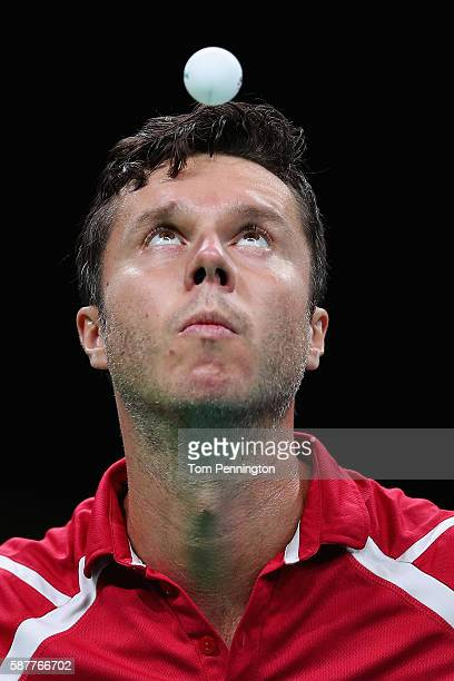 Vladimir Samsonov of Belarus competes against Dimitrij Ovtcharov of Germany during the Men's Singles Quarterfinal 3 Table Tennis on Day 4 of the Rio...