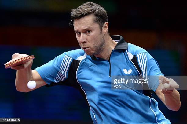 Vladimir Samsonov of Belarus competes against Zhagn Jike of China during the fourth round of men's singles match on day six of the 2015 World Table...