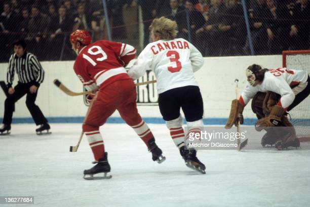 Vladimir Shadrin of the Soviet Union battles with Pat Stapleton of Canada as goalie Ken Dryden defends the net during the 1972 Summit Series at the...