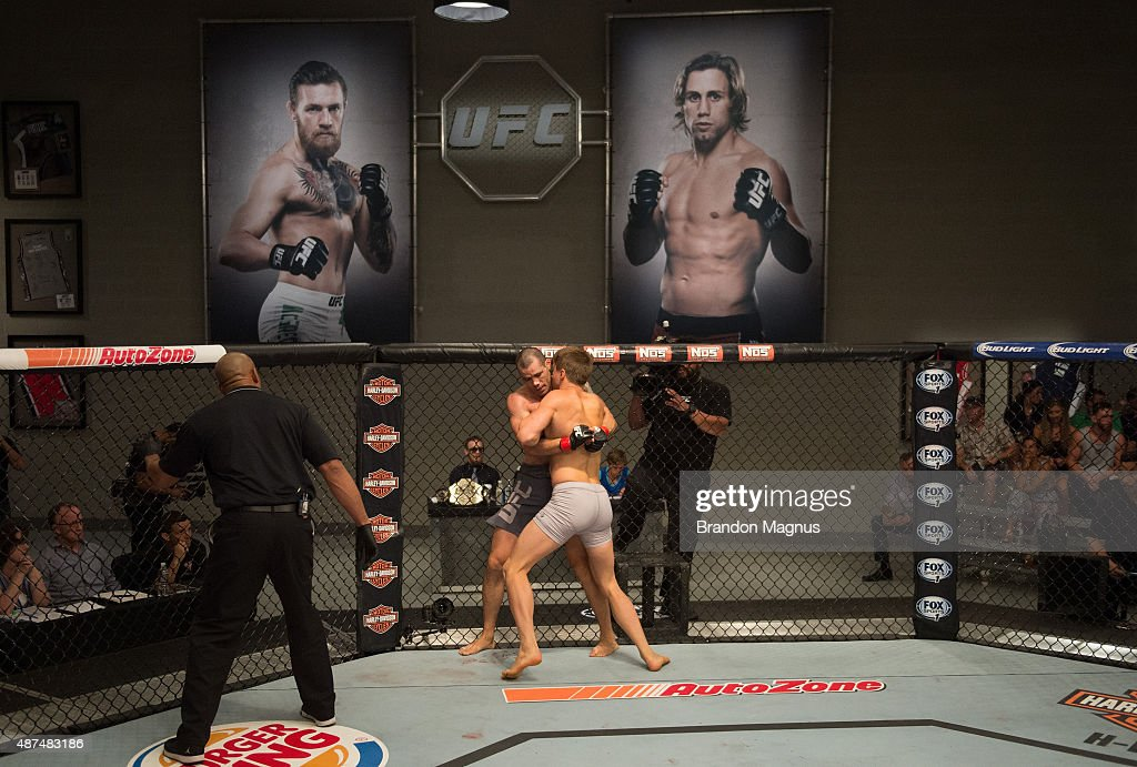 Vladimir Sikic pushes Abner Lloveras up against the cage during the elimination fights at the UFC TUF Gym on July 17 2015 in Las Vegas Nevada