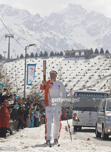 Vladimir Smirnov Olympic ski champion runs with the Olympic torch in Almaty on April 2 2008 Kazakhstan is the first stop in the international leg of...