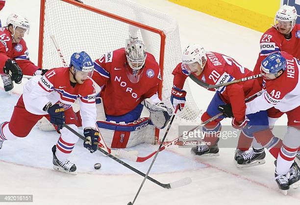 Vladimir Sobotka and Tomas Hertl of Czech Republic battle the puck with captain Anders Bastiansen and Lars Haugen of Norway during the 2014 IIHF...