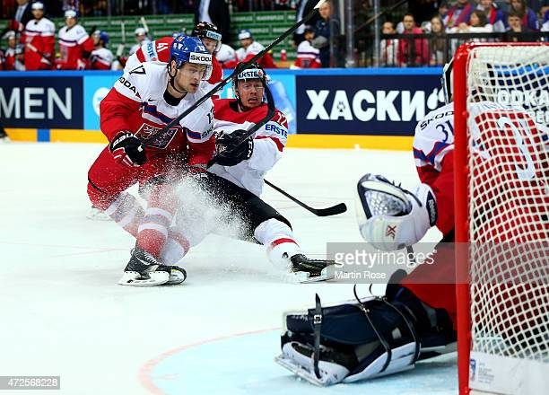 Vladimir Sobotka of Czech Republic and Michael Raffl of Austria battle for the puck during the IIHF World Championship group A match between Czech...