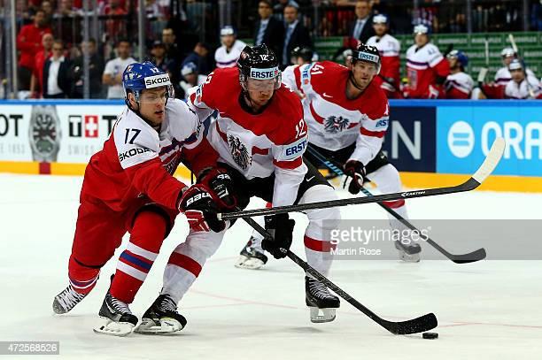 Vladimir Sobotka of Czech Republic and Michael Raffl of Austria battle for the puck during the IIHF World Championship group A match between Czech...