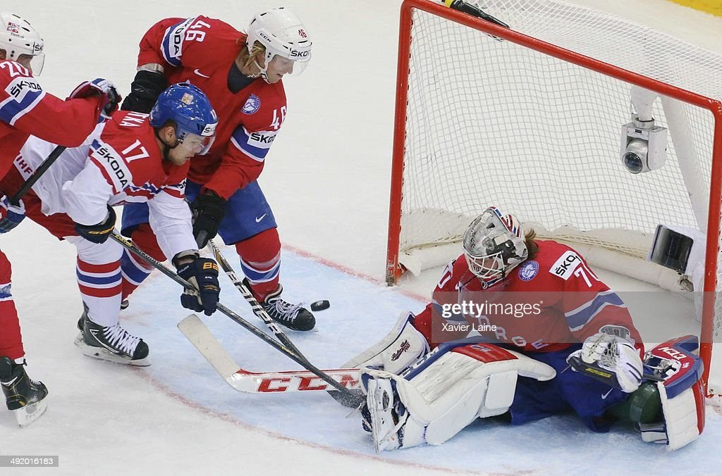 <a gi-track='captionPersonalityLinkClicked' href=/galleries/search?phrase=Vladimir+Sobotka&family=editorial&specificpeople=716736 ng-click='$event.stopPropagation()'>Vladimir Sobotka</a> #17 of Czech Republic is push by <a gi-track='captionPersonalityLinkClicked' href=/galleries/search?phrase=Mathis+Olimb&family=editorial&specificpeople=2288763 ng-click='$event.stopPropagation()'>Mathis Olimb</a> #46 and <a gi-track='captionPersonalityLinkClicked' href=/galleries/search?phrase=Lars+Haugen&family=editorial&specificpeople=7718894 ng-click='$event.stopPropagation()'>Lars Haugen</a> #30 of Norway during the 2014 IIHF World Championship between Czech Republic and Norway at Chizhovka arena ,on May 18, 2014 in Minsk, Belarus.