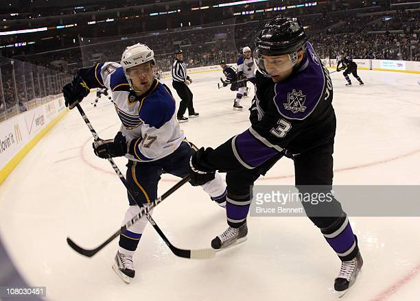 Vladimir Sobotka of the St Louis Blues and Jack Johnson of the Los Angeles Kings battle for the puck at the Staples Center on January 13 2011 in Los...