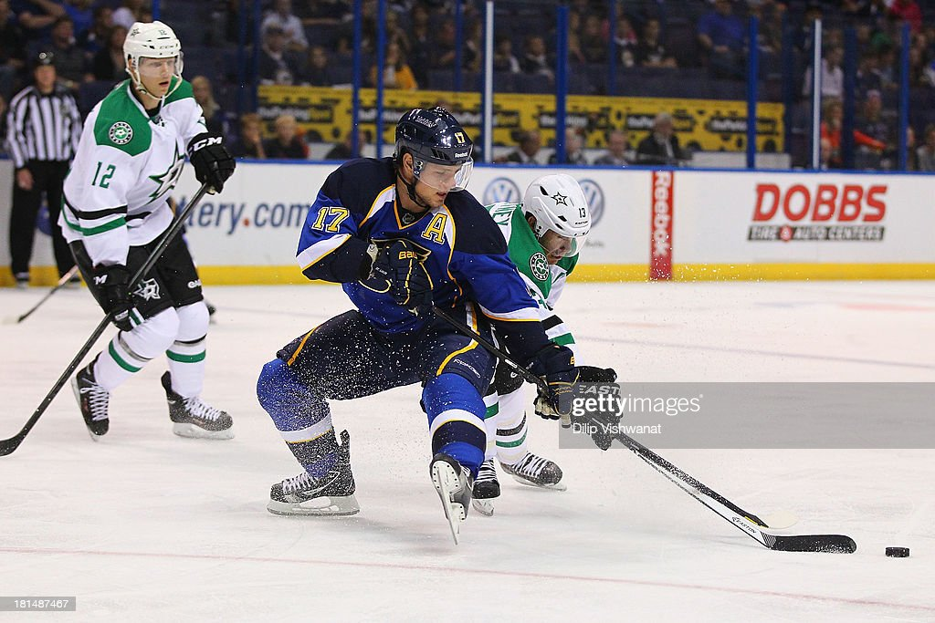 Vladimir Sobotka #17 of the St. Louis Blues and <a gi-track='captionPersonalityLinkClicked' href=/galleries/search?phrase=Ray+Whitney&family=editorial&specificpeople=202090 ng-click='$event.stopPropagation()'>Ray Whitney</a> #13 of the Dallas Stars chase down a loose puck during a preseason game at the Scottrade Center on September 21, 2013 in St. Louis, Missouri.