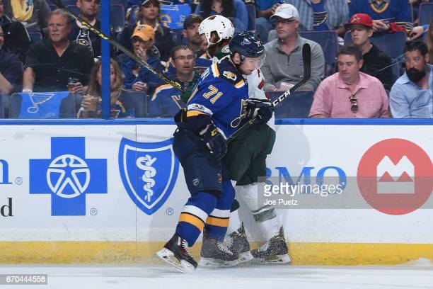Vladimir Sobotka of the St Louis Blues checks Ryan White of the Minnesota Wild in Game Four of the Western Conference First Round during the 2017 NHL...