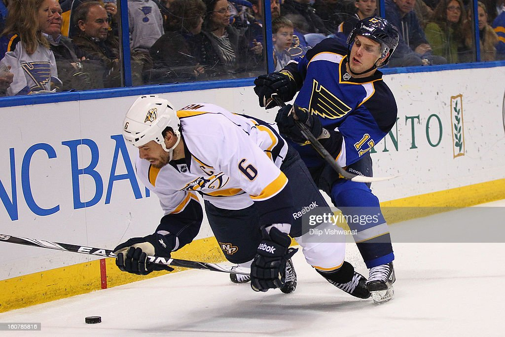 <a gi-track='captionPersonalityLinkClicked' href=/galleries/search?phrase=Vladimir+Sobotka&family=editorial&specificpeople=716736 ng-click='$event.stopPropagation()'>Vladimir Sobotka</a> #17 of the St. Louis Blues checks <a gi-track='captionPersonalityLinkClicked' href=/galleries/search?phrase=Shea+Weber&family=editorial&specificpeople=554412 ng-click='$event.stopPropagation()'>Shea Weber</a> #6 of the Nashville Predators to the ice at the Scottrade Center on February 5, 2013 in St. Louis, Missouri.