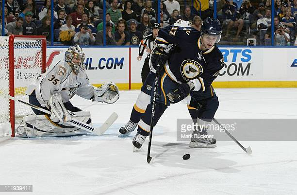 Vladimir Sobotka of the St Louis Blues handles the puck as Pekka Rinne of the Nashville Predators defends in an NHL game on April 9 2011 at Scottrade...
